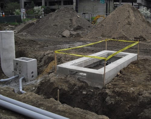 Once the unit is set and leveled the hole is backfilled.