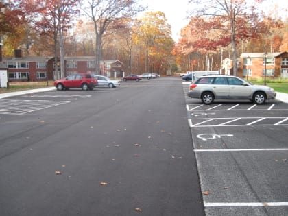 University of Connecticut, Porous Asphalt parking stalls alongside traditional asphalt drive aisle