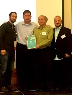 Boston Mayor Martin Walsh (second from left) presented a Greenovate Boston Award to Michael Chavez, Fairmount/Indigo Line Enterprise Rose Architectural Fellow; Matt Thall, Fairmount/Indigo Corridor-wide Advisory Group; and Trevor Smith, Land Escapes Design, Inc.