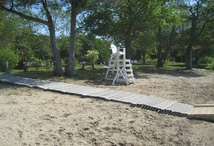 The project specifically addressed accessibility along the beach and to the water. A roll-out boardwalk from Mr. Boardwalk Company, installed in 2003, still functions well.  (