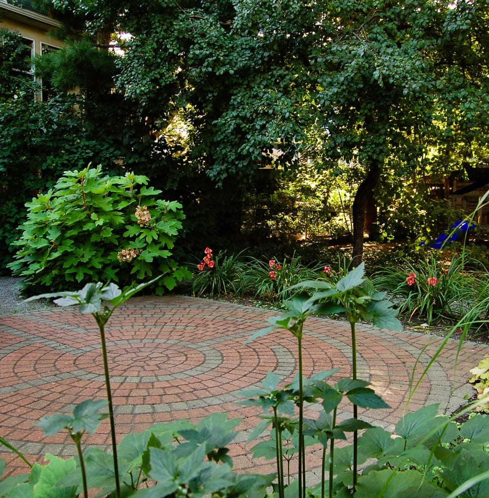 Low-maintenance planting, wheelchair-accessible stonedust walkways and raised beds, and a walking labyrinth create sacred space on the shady lot of an urban congregation. Design & Installation: A Yard & A Half; Photo: Jesse Edsell-Vetter.