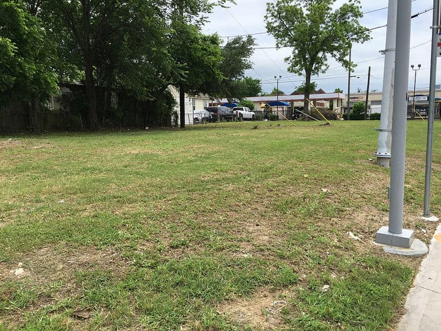 The site is an empty lot on Fulton St between Panama St and Hammock St, across from a METRO light rail stop.