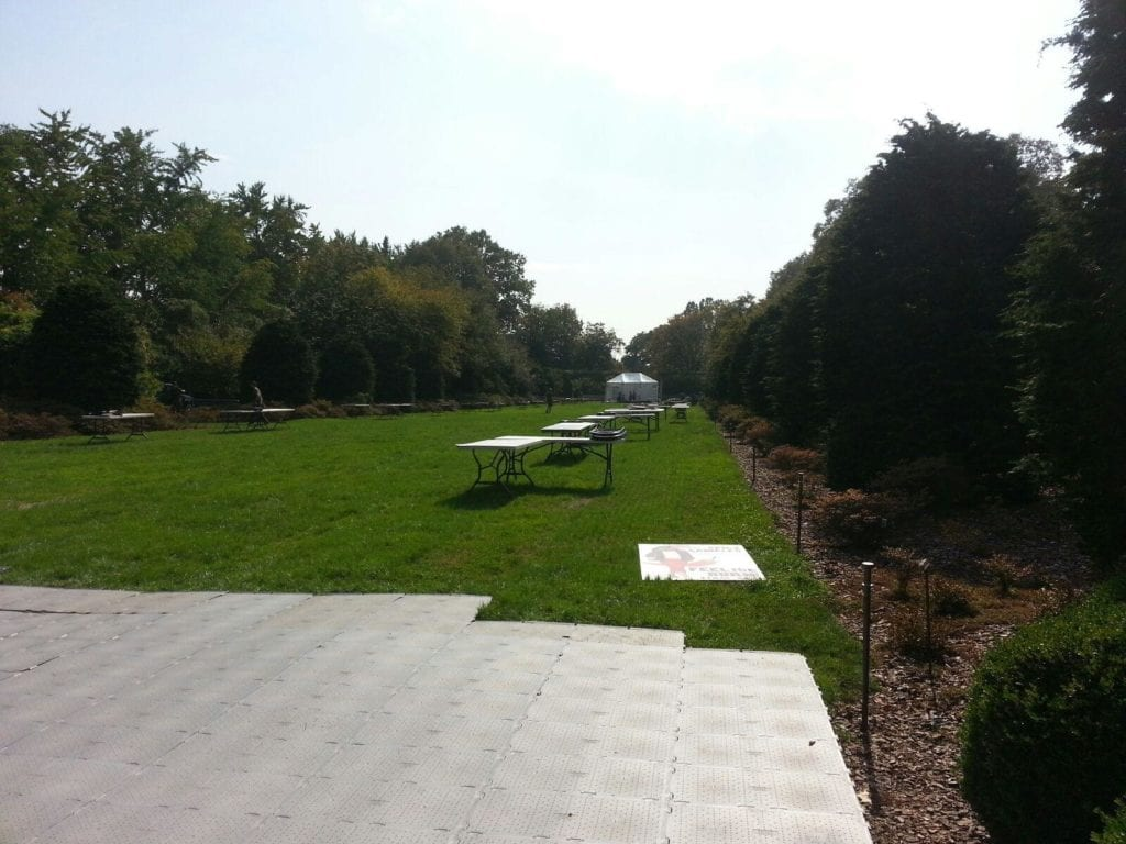 Installed before a major event, compaction mats protected the lawn at the location of a temporary stage.