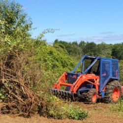 Forest Savers LLC from Woodstock, Vermont uses a custom-built tractor to uproot and shred invasive shrubs at the Oyster River Forest in Durham, NH as part of a 60-acre restoration project to restore a healthy native plant community to benefit pollinators, songbirds, and the state-endangered New England cottontail.