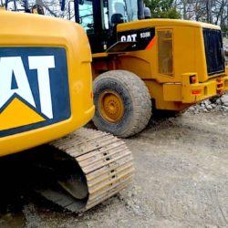 Figure 4: Heavy soil moving machines commonly used for excavation and moving piles of excavated soil during foundation digging. There are smaller versions of these for smaller sites, but they still cause severe soil compaction.